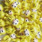 """GINZA LOFT """"Daruma Uamou Yellow"""" 銀座ロフトのグランドオープンを記念して開催される『TOKYO SOFVI WEEK』に参加します。 ダルマUAMOU(黄) 4000円(税込) 2月に青、赤とリリースされ大好評を博したダルマUAMOUに、新色が仲間入り! ロフトを象徴する色といえば!の黄色のボディに、高木綾子がひとつひとつにペイントを施しました。 厳めしかったり、愛嬌があったり…様々な表情から、あなたのお気に入りの1体を見つけてください!"""